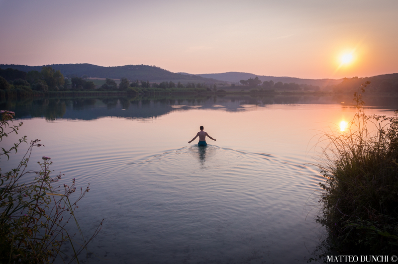 Sunrise bath in an hidden lake, after spending the night in a tent made of bicycle frames. Picture by Matteo Dunchi.