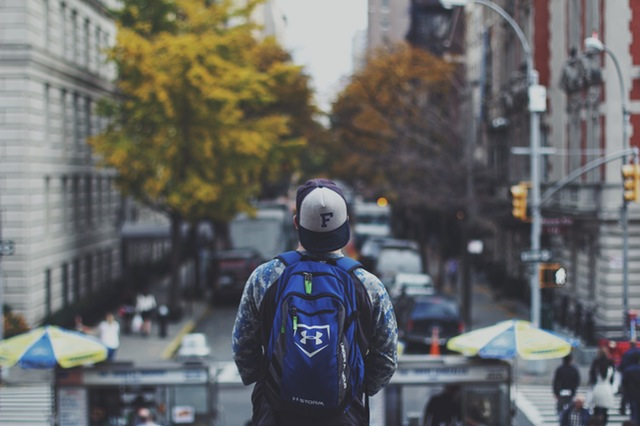 Traveler boy with a backpack.