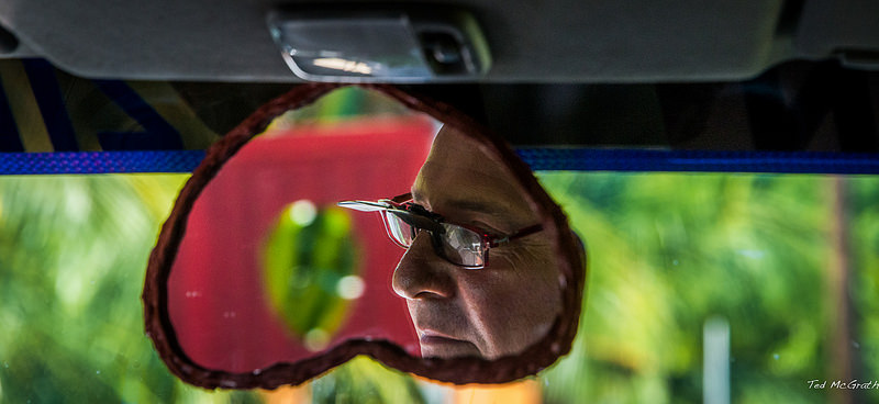 Taxy driver in the rear-view mirror.