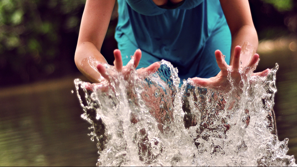 Water splashes with hands.