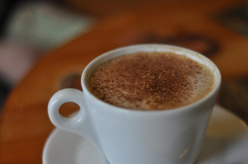 A caffè macchiato with cinnamon.