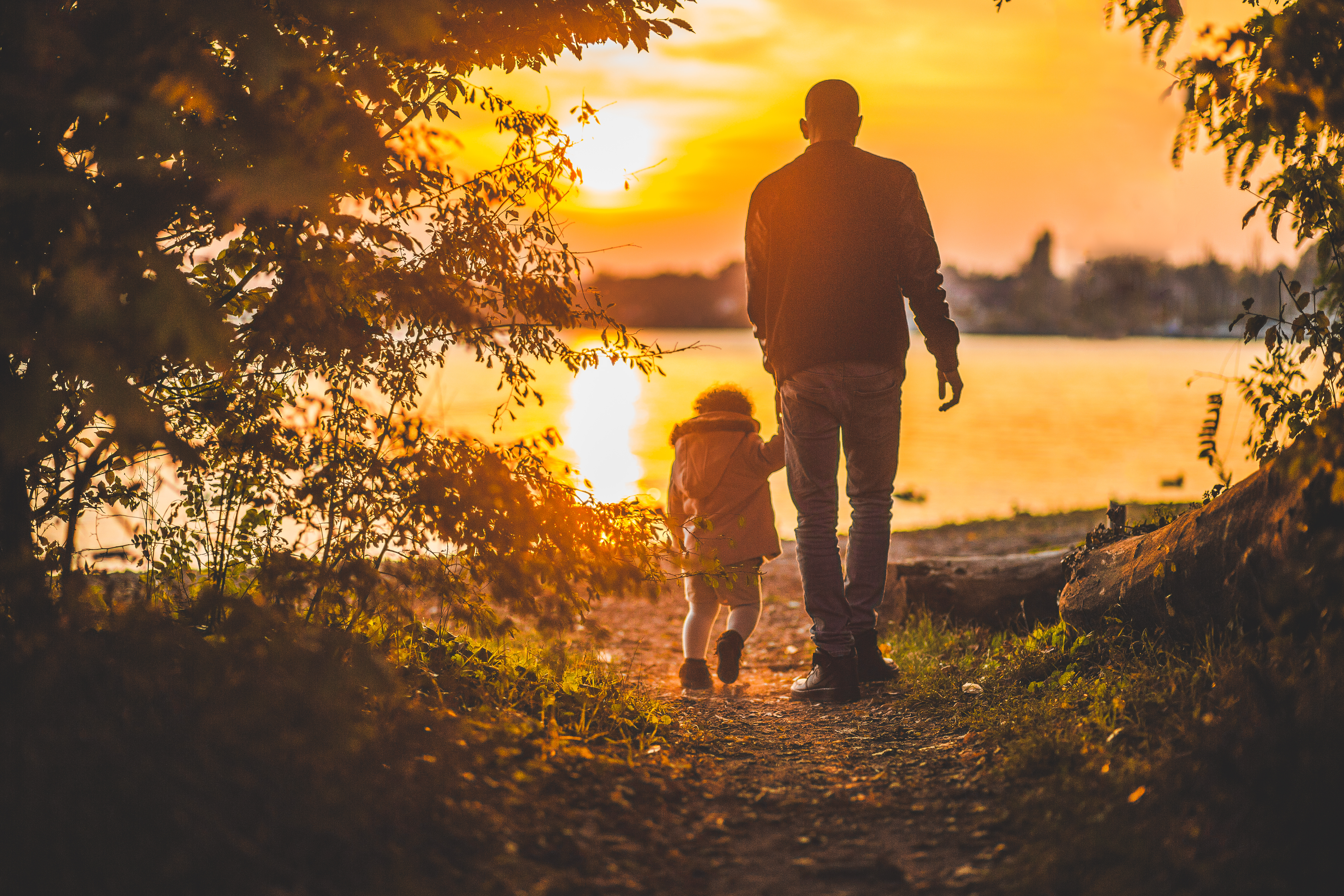 Father and daughter at sunset.