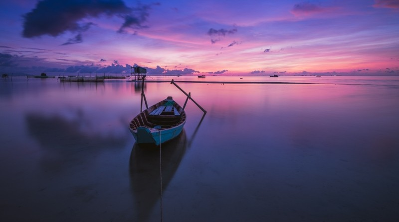 Boat on the sea at sunset.